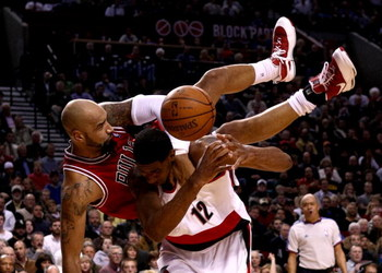 PORTLAND, OR - NOVEMBER 19:  Drew Gooden #90 of the Chicago Bulls falls over the top of LaMarcus Aldridge #12 of the Portland Trail Blazers  at the Rose Garden November 18, 2008 in Portland, Oregon.  NOTE TO USER: User expressly acknowledges and agrees th