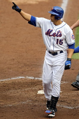 NEW YORK - SEPTEMBER 28:  Carlos Beltran #15 of the New York Mets salutes the fans after hitting a two run home run against the Florida Marlins during the last regular season baseball game ever played in Shea Stadium on September 28, 2008 in the Flushing