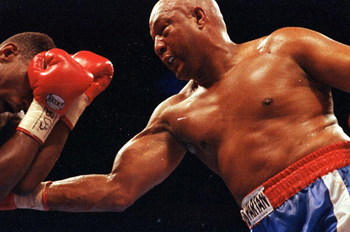 11 Apr 1992: George Foreman makes a right puch during a fight against Alex Stewart. Mandatory Credit: Holly  Stein  /Allsport