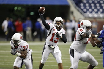 DETROIT - DECEMBER 5:  Quarterback Nate Davis #13 of the Ball State Cardinals throws a pass against the Buffalo Bulls during the MAC Championship game on December 5, 2008 at Ford Field in Detroit Michigan. (Photo by: Gregory Shamus/Getty Images)