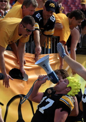TAMPA, FL - JANUARY 01:  Mitch King #47 of the Iowa Hawkeyes celebrates with fans after a 31-10 victory over the South Carolina Gamecocks during the Outback Bowl on January 1, 2009 at Raymond James Stadium in Tampa, Florida.  (Photo by Scott Halleran/Gett