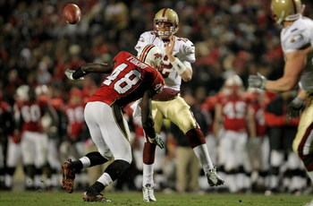 COLLEGE PARK, MD - NOVEMBER 10:  Quarterback Matt Ryan #12 of the Boston College Eagles delivers an incomplete pass as Moise Fokou #48 of the Maryland Terrapins provides pressure at Byrd Stadium on November 10, 2007 in College Park, Maryland.  (Photo by D