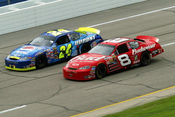 TALLADEGA, AL - APRIL 25:   Jeff Gordon, driver of the #24 Hendrick Motorsports Chevrolet, races alongside Dale Earnhardt, Jr., driver of the #8 Budweiser Chevrolet, in the final laps of the Aaron's 499 on April 25, 2004 at the Talladega SuperSpeedway in