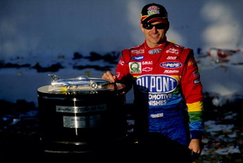 14 Feb 1999:  Jeff Gordon #24 poses with the trophy after winning the NASCAR Daytona 500 at the Daytona International Speedway in Daytona, Florida. Mandatory Credit: Jamie Squire  /Allsport