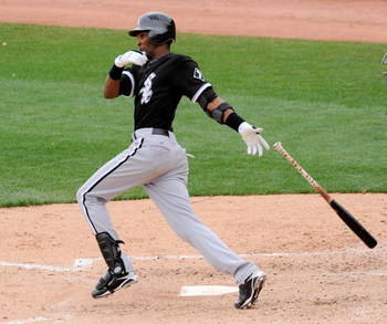 GLENDALE, AZ - MARCH 05:  Alexei Ramirez #10 of the Chicago White Sox gets a base hit against the Los Angeles Dodgers during a spring trainning game at Camelback Ranch on March 5, 2009, in Glendale, Arizona.  (Photo by Kevork Djansezian/Getty Images)