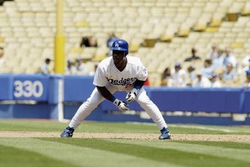 LOS ANGELES - JULY 24:  Left fielder Rickey Henderson #25 of the Los Angeles Dodgers studies the pitcher as he leads off of first base during the National League game against the Colorado Rockies at Dodger Stadium on July 24, 2003 in Los Angeles, Californ