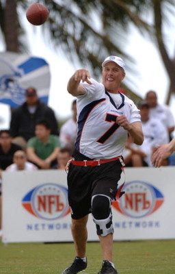 John Elway releases a pass during an alumni air it out flag football game February 10 before  the 2006 Pro Bowl in Honolulu.  (Photo by Al Messerschmidt/Getty Images)