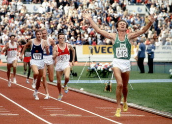 HELSINKI - AUGUST 14:  Eamonn Coghlan of Ireland raises his arms in the air as he crosses the line to win the 5000 Metres final during the 1983 World Championships held on August 14, 1983 at the Olympic Stadium, in Helsinki, Finland. (Photo by Steve Powel