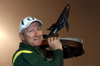 SAN DIEGO, CA - DECEMBER 30:   Head Coach Mike Bellotti of the University of Oregon Ducks holds the winner's trophy after beating the Oklahoma State University Cowboys in the Pacific Life Holiday Bowl at Qualcomm Stadium on December 30, 2008 in San Diego,