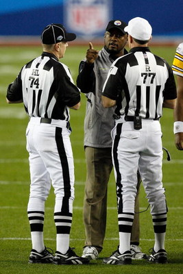 TAMPA, FL - FEBRUARY 01:  Head coach Mike Tomlin of the Pittsburgh Steelers argues with head linesman Derick Bowers #74 and referee Terry McAulay #77 against the Arizona Cardinals during Super Bowl XLIII on February 1, 2009 at Raymond James Stadium in Tam
