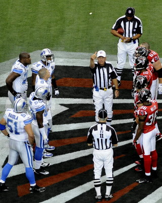ATLANTA, GA - SEPTEMBER 7: NFL referee Ron Winter tosses the coin as the Atlanta Falcons host the Detroit Lions at the Georgia Dome on September 7, 2008 in Atlanta, Georgia.  (Photo by Al Messerschmidt/Getty Images)