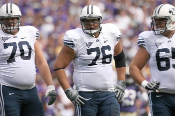 SEATTLE - SEPTEMBER 6:  (L-R) Matt Reynolds #70, Ray Feinga #76 and Dallas Reynolds #65 of the BYU Cougars look on during a break in game action against the Washington Huskies on September 6, 2008 at Husky Stadium in Seattle, Washington. The Cougars defea