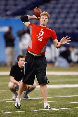 INDIANAPOLIS, IN - FEBRUARY 22:  Quarterback Hunter Cantwell of Louisville drops back to pass the football during the NFL Scouting Combine presented by Under Armour at Lucas Oil Stadium on February 22, 2009 in Indianapolis, Indiana. (Photo by Scott Boehm/