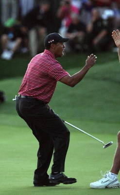 ORLANDO, FL - MARCH 29:  Tiger Woods of the USA holes for a winning birdie at the 18th hole during the final round of the Arnold Palmer Invitational Presented by Mastercard at the Bay Hill Club and Lodge on March 29, 2009 in Orlando, Florida  (Photo by Da