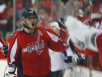 WASHINGTON - MARCH 27: Alex Ovechkin #8 of the Washington Capitals celebrates a Caps goal against the Tampa Bay Lightning on March 27, 2009 at the Verizon Center in Washington, D.C. (Photo by Bruce Bennett/Getty Images)