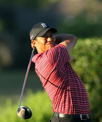 ORLANDO, FL - MARCH 29:  Tiger Woods of the USA watches his tee shot at the 16th hole during the final round of the Arnold Palmer Invitational Presented by Mastercard at the Bay Hill Club and Lodge on March 29, 2009 in Orlando, Florida  (Photo by David Ca