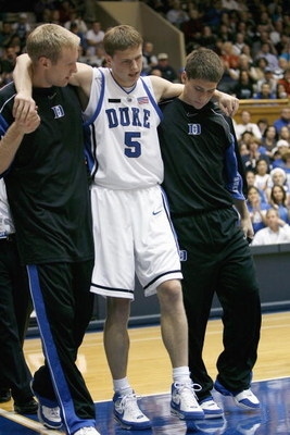 DURHAM, NC - NOVEMBER 25: Martynas Pocius #5 of the Duke Blue Devils is helped off court during the game against the Eastern Kentucky Colonels at Cameron Indoor Stadium on November 25, 2007 in Durham, North Carolina. Duke defeated Eastern Kentucky 78-43.