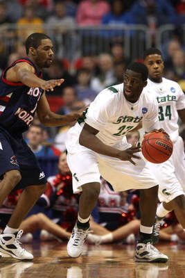 MINNEAPOLIS - MARCH 20:  Draymond Green #23 of the Michigan State Spartans looks to move the ball against the Robert Morris Colonials during the first round of the NCAA Division I Men's Basketball Tournament at the Hubert H. Humphrey Metrodome on March 20