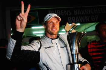 KUALA LUMPUR, MALAYSIA - APRIL 05:  Jenson Button of Great Britain and Brawn GP celebrates in the paddock after winning the rain curtailed Malaysian Formula One Grand Prix at the Sepang Circuit on April 5, 2009 in Kuala Lumpur, Malaysia.  (Photo by Mark T