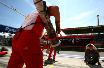 NURBURG, GERMANY - JULY 21:  Ferrari mechanics get ready to practice refuelling Felipe Massa of Brazil and Ferrari during practice prior to qualifying for the European Grand Prix at Nurburgring on July 21, 2007 in Nurburg, Germany.  (Photo by Paul Gilham/