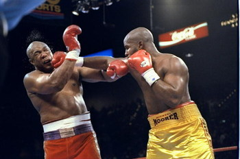 5 Nov 1994:  George Foreman (left) and Michael Moorer trade blows during a bout in Las Vegas, Nevada.  Foreman won the fight with a 10th round knockout. Mandatory Credit: Holly Stein  /Allsport