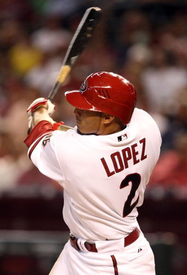 PHOENIX - APRIL 06:  Felipe Lopez #2 of the Arizona Diamondbacks hits a solo home run against the Colorado Rockies during the first inning of the MLB openning day game at Chase Field on April 6, 2009 in Phoenix, Arizona.  (Photo by Christian Petersen/Gett