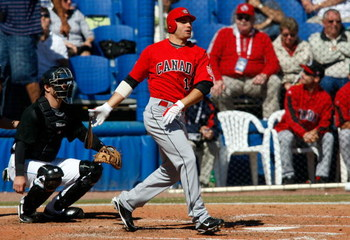 DUNEDIN, FL - MARCH 03:  Infielder Joey Votto #19 of Team Canada fouls off a pitch against the Toronto Blue Jays during a exhibition spring training game at Dunedin Stadium on March 3, 2009 in Dunedin, Florida.  (Photo by J. Meric/Getty Images)
