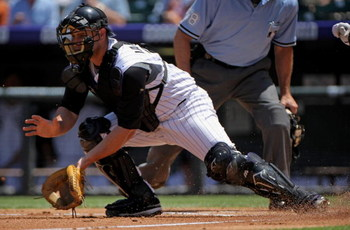 DENVER - JULY 20:  Catcher Chris Iannetta #20 of the Colorado Rockies takes a throw at the plate against the Pittsburgh Pirates at Coors Field on July 20, 2008 in Denver, Colorado. The Rockies defeated the Pirates 11-3.  (Photo by Doug Pensinger/Getty Ima