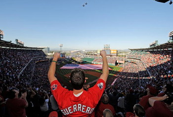 ANAHEIM, CA - APRIL 06:  A fan celebrates after the national anthem during Los Angeles Angels opening day ceremonies against the Oakland Athletics at the Angels Stadium of Anaheim on April 6, 2009 in Anaheim, California.  (Photo by Kevork Djansezian/Getty
