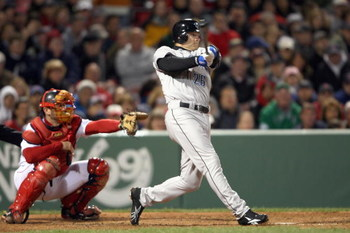 BOSTON - APRIL 29: Adam Lind #26 of the Toronto Blue Jays swings at a pitch during the MLB game against the Boston Red Sox on April 29, 2008 at Fenway Park in Boston, Massachusetts. (Photo by Elsa/Getty Images)