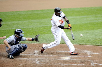 BALTIMORE - MAY 1:  Adam Jones #10 of the Baltimore Orioles hits a home run in the fourth inning against the Tampa Bay Rays May 1, 2008 at Camden Yards in Baltimore, Maryland.  (Photo by Greg Fiume/Getty Images)