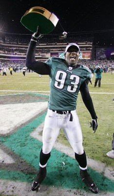 PHILADELPHIA - JANUARY 23:  Defense end Jevon Kearse #93 of the Philadelphia Eagles celebrates with the George Halas NFC Championship trophy after defeating the Atlanta Falcons 27-10 in the NFC Championship game at Lincoln Financial Field on January 23, 2