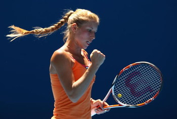 MELBOURNE, AUSTRALIA - JANUARY 24:  Alona Bondarenko of the Ukraine celebrates winning a point in her third round match against Svetlana Kuznetsova of Russia during day six of the 2009 Australian Open at Melbourne Park on January 24, 2009 in Melbourne, Au