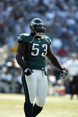 PHILADELPHIA - SEPTEMBER 29:  Defensive end Hugh Douglas #53 of the Philadelphia Eagles stands on the field during the NFL game against the Houston Texans on September 29, 2002 at Veterens Stadium in Philadelphia, Pennsylvania.  The Eagles won 35-17.  (Ph