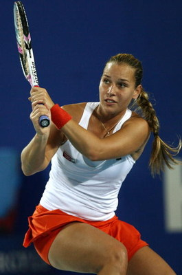 PERTH, AUSTRALIA - JANUARY 05:  Dominika Cibulkova of the Slovak Republic returns a shot to Meghann Shaughnessy of the USA during the womens singles match between the Slovak Republic and the USA during day three of the 2009 Hopman Cup at Burswood Dome on
