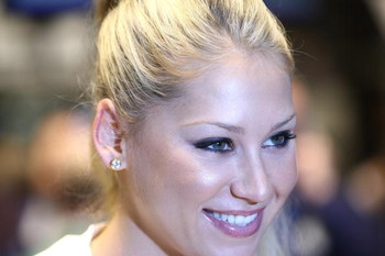 NEW YORK - MARCH 25:  Professional tennis player and model Anna Kournikova poses for a photograph at the New York Stock Exchange opening bell on March 25, 2009 in New York City.  (Photo by Neilson Barnard/Getty Images)