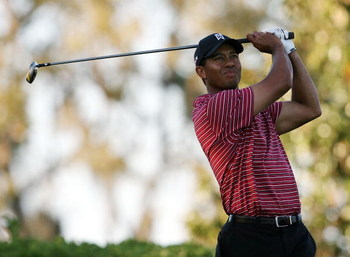 ORLANDO, FL - MARCH 29:  Tiger Woods hits his tee shot on the 15th hole during the final round of the Arnold Palmer Invitational Presented by Mastercard at the Bay Hill Club and Lodge on March 29, 2009 in Orlando, Florida   (Photo by Doug Benc/Getty Image