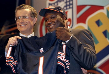 18 Apr 1998:  Fifth overall pick Curtis Enis shows off his jersey alongside NFL commissioner Paul Tagliabue after being selected by the Chicago Bears in the first round of the 1998 NFL Draft at Madison Square Garden in Manhattan, New York. Mandatory Credi