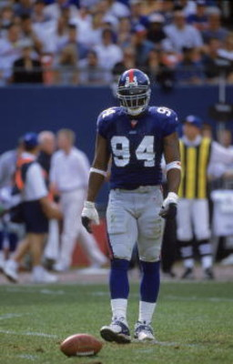 15 Oct 2000:  Cedric Jones #94 of the New York Giants walks on the field during the game against the Dallas Cowboys at the Giants Stadium in East Rutherford, New Jersey. The Giants defeated the Cowboys 19-14.Mandatory Credit: Harry How  /Allsport