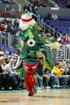 LOS ANGELES - MARCH 13:  The Stanford University Cardinal's Tree runs during an intermission in the Pac-10 Tournament against the University of Southern California Trojans at Staples Center on March 13, 2003 in Los Angeles, California.  USC defeated Stanf