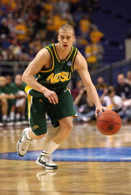 MINNEAPOLIS - MARCH 20:  Ben Woodside #10 of the North Dakota State Bison drives the ball against the Kansas Jayhawks during the first round of the NCAA Division I Men's Basketball Tournament at the Hubert H. Humphrey Metrodome on March 20, 2009 in Minnea