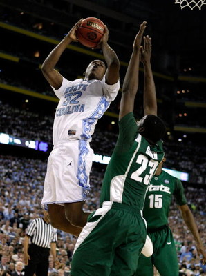 DETROIT - APRIL 06:  Ed Davis #32 of the North Carolina Tar Heels drives for a shot attempt in the first half against Draymond Green #23 of the Michigan State Spartans during the 2009 NCAA Division I Men's Basketball National Championship game at Ford Fie