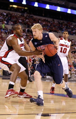 INDIANAPOLIS - MARCH 27:  Chase Budinger #34 of the Arizona Wildcats drives against the Louisville Cardinals  during the third round of the NCAA Division I Men's Basketball Tournament at the Lucas Oil Stadium on March 27, 2009 in Indianapolis, Indiana. Lo