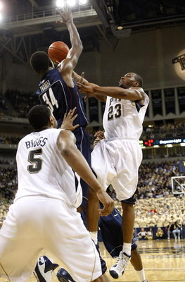 PITTSBURGH - MARCH 07:  Sam Young #14 of the Pittsburgh Panthers tries to get to the basket past Hasheem Thabeet #34 of the Connecticut Huskies on March 7, 2009 at the Petersen Events Center in Pittsburgh, Pennsylvania.  (Photo by Gregory Shamus/Getty Ima