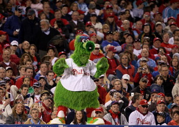 PHILADELPHIA - APRIL 05:  Phillie Phanatic cheers for the Philadelphia Phillies duirng their game against the Atlanta Braves on April 5, 2009 at Citizens Bank Park in Philadelphia, Pennsylvania.  (Photo by Ezra Shaw/Getty Images)