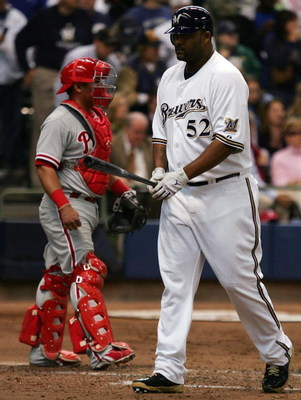 MILWAUKEE - OCTOBER 05:  Pinch hitter C.C. Sabathia #52 of the Milwaukee Brewers walks back to the dugout past catcher Carlos Ruiz #51 of the Philadelphia Phillies after striking out in game four of the NLDS during the 2008 MLB playoffs at Miller Park on