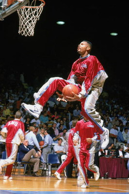 1990:  Hank Gathers #44  of the Loyola  Marymount Lions drives to the basket for a left handed throught the legs layup during warmups in 1990. Hank Gathers was one of the nation's top college basketball players in the late 1980's and early 1990's before c