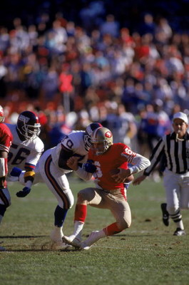 SAN FRANCISCO - JANUARY 20:  Joe Montana #16 the San Francisco 49ers gets sacked by New York Giants defensive tackle Leonard Marshall #70 during the 1990 NFC Championship game at Candlestick Park on January 20, 1991 in San Francisco, California.  The Gian