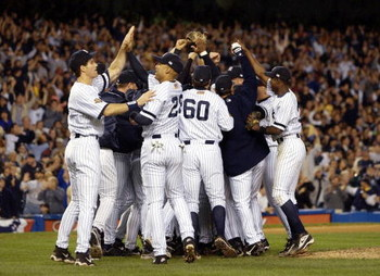 22 Oct 2001:  The New York Yankees celebrate after they won game Game 5 of the American League Championship Series between the Seattle Mariners and the New York Yankees at Yankee Stadium in the Bronx, New York. Yankees won the game 12-3 to move on to the