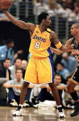 19 Jun 2000:  Kobe Bryant #8 of the Los Angeles Lakers looks to pass the ball while Reggie Miller #31 of the Indiana Pacers guards him during the NBA Finals Game 6 at the Conseco Fieldhouse in Indianapolis, Indiana.  The Lakers defeated the Pacers 116-111
